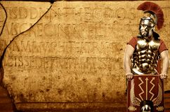 Roman legionary soldier. In front of abstract wall Stock Image