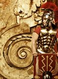 Roman legionary soldier. In front of abstract wall Stock Photo