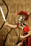 Roman legionary soldier. In front of abstract wall Stock Photos