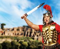 Roman legionary soldier. In front old city of Rome Stock Image