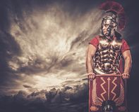 Roman legionary soldier. Legionary soldier against stormy sky Royalty Free Stock Photography