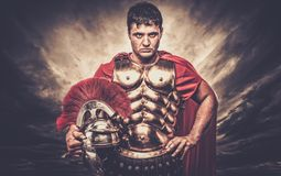 Roman legionary soldier. Legionary soldier against stormy sky Stock Photography
