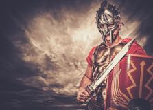 Roman legionary soldier. Legionary soldier against stormy sky Stock Photo