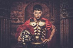 Roman legionary soldier. In front of ancient building Stock Photography