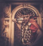 Roman legionary soldier. In front of ancient building Royalty Free Stock Images