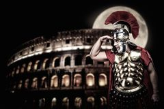 Roman legionary soldier. In front of coliseum at night time Royalty Free Stock Photo