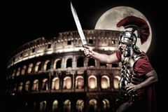 Roman legionary soldier. In front of coliseum at night time Royalty Free Stock Images