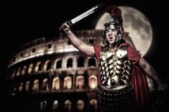 Roman legionary soldier. In front of coliseum at night time Stock Images