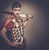 Roman legionary soldier. Legionary soldier with a sword Stock Photo