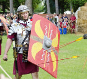 Roman legionnaire with shield and stucked arrows Royalty Free Stock Photography