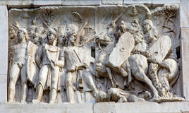 Roman Legionnaires Military Battle Arch of Constantine Rome Italy. Arch built in 315 AD to celebrate Emperor Constantine`s victory in 312 over co-emperor Stock Photos