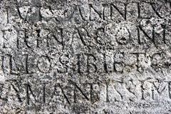 Roman letters stone texture Royalty Free Stock Photo