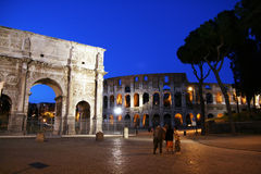 Roman lights. The ancient arch of constantine and the colosseum by night at rome in italy Royalty Free Stock Photo