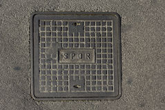 Roman manhole. With the latin abbreviation SPQR on the concrete street Royalty Free Stock Images