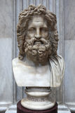 Roman marble bust of Zeus. ROME, ITALY - DECEMBER 19, 2011: Roman marble bust of Zeus displayed in the Museo Pio Clementino of the Vatican Museums in Rome, Italy Royalty Free Stock Photos