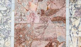 Roman marble floor background. Colorful ancient roman marble floor, weathered and broken, heritage of italian history. Beautiful background and texture, vintage royalty free stock image