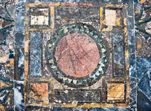 Roman marble floor background. Colorful ancient roman marble floor, weathered and broken, heritage of italian history. Beautiful background and texture, vintage royalty free stock photos
