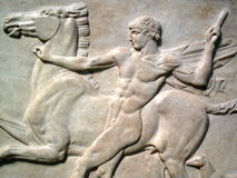 Roman Marble Relief AD125. Of a naked youth with his horse and dog, found  at Emperor Hadrian's villa in Tivoli Royalty Free Stock Photos