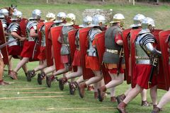 Roman Marching Army. Roman army marching wearing helmets,armour,sandals, and carrying shields,swords and daggers Royalty Free Stock Photos