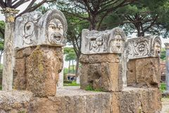 Roman masks in the old town of Ostia, Rome, Italy Stock Image