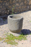 Roman Mortar - Pompeii. A stone-made roman mortar in Pompeii, an ancient Roman town-city near modern Naples in the Italian region of Campania which was mostly Stock Image