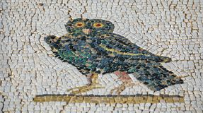 Roman mosaic floor with owl and shallow depth of field. Details of Roman mosaic floor with owl and shallow depth of field stock photo
