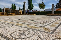 Roman mosaic floor with shallow depth of field and tourists. Details of Roman mosaic floor with blurred tourists in the background, shallow depth of field stock image