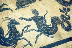 Roman mosaic. Neptune riding a horses. Art made from mosaic in Ostia Antica Royalty Free Stock Images