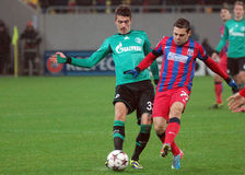 Roman Neustädter and Adrian Popa during UEFA Champions League game. Roman Neustädter and Adrian Popa pictured in action during the UEFA Champions League royalty free stock image