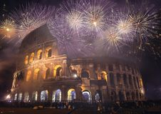 A Roman New Years - Colosseum. Rome celebrates the New Year with fireworks above the infamous landmark, the Colosseum Stock Images