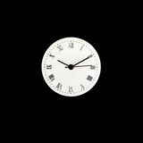 Roman number clock surface on grey background Royalty Free Stock Images