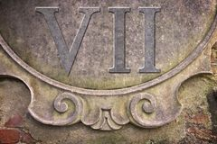 Roman number written on stucco wall - concept image.  stock photo