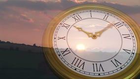 Roman numeral clock over sun set. Digital animation of Roman numeral clock over sun set stock footage