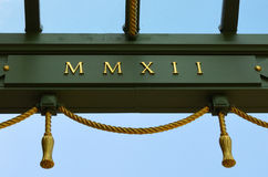 Roman Numerals 2012. LONDON, UK : May, 2012. Part of a major revamp of Kensington Palace a new loggia is erected in honour of HM The Queen's Diamond Jubilee. The Royalty Free Stock Images