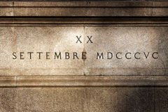 Roman numerals on bas-relief on travertine stone. Equestrian monument of garibaldi. Rome, Italy Stock Photography
