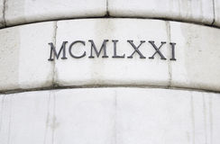 Roman numerals. In historic building architecture royalty free stock photography