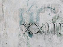 Roman numerals 23. Roman numeral numbers twenty-three on weathered white metal background stock image