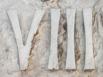 Roman numerals. Sculpture showing the number royalty free stock image