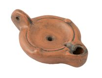 Roman oil lamp. Isolated Roman oil lamp (reproduction Royalty Free Stock Image