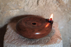 Roman oil lamp. Beside a house door Royalty Free Stock Photos