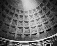 Roman Pantheon Dome With Light. The interior ceiling of the dome of the Pantheon in Rome with a single beam of light from the opening (oculus) at the top Royalty Free Stock Photography