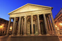 The Roman Pantheon at Sunrise. The Pantheon in Rome, Italy glows as the morning sky begins to brighten behind it Royalty Free Stock Photos