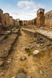 Roman path and buildings at Ostia Antica Italy Royalty Free Stock Photos