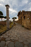 Roman path with columns and buildings at Ostia Antica Italy Royalty Free Stock Photos