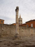 Roman pillar by the wall Stock Photography