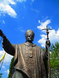 Roman Pontiff, John Paul the second, Kamenets Podolskiy, Ukraine. Bronze statue of Roman Pontiff who spread out his arms with love and piece Stock Photography