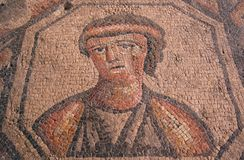 Roman portrait of a sad woman in mosaic. Detail of a woman on a mosaic floor in a ruined ancient roman church in the once great town of Aquileia, probably dating Royalty Free Stock Photos