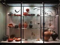 Roman pottery and tool exhibit. Ancient Roman pottery and tool finds Royalty Free Stock Photography