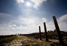 Roman road in ancient Thamugadi Stock Photos