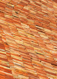 Roman roof tiles. Old roman clay roof tiles on an old building in the mediterranean Stock Photos